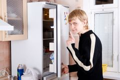 The guy near to a refrigerator Royalty Free Stock Photography