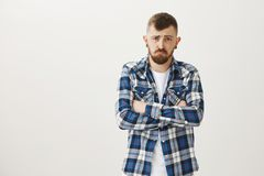 Guy never will speak with rude people again. Portrait of miserable offended mature male coworker in plaid shirt, holding. Hands crossed on chest and sulking stock photo