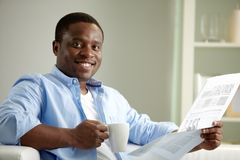 Guy with newspaper Stock Photo