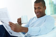 Guy with newspaper Royalty Free Stock Photo