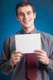 Guy with notecard, smiling. Young businessman with notecard, smiling Royalty Free Stock Photo