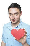 Guy offering his heart Royalty Free Stock Photos