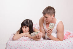 Guy offers offended girl money Royalty Free Stock Image