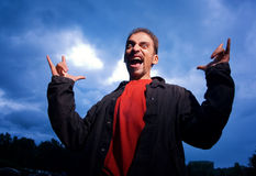 Guy over dark cloudy sky Stock Photo