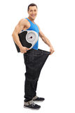 Guy in an oversized pair of jeans Royalty Free Stock Image