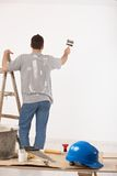Guy painting wall Royalty Free Stock Photography