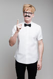Guy with paper mustache Stock Image