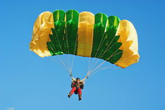 The guy parachutist in red overalls Royalty Free Stock Image