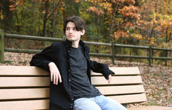 Guy on park bench Stock Image
