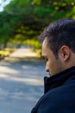 Guy in a park looking back Royalty Free Stock Image