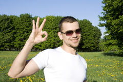 The guy in park. Sign ОК Royalty Free Stock Images