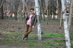 The guy in the park. Young boy walks in the early spring in a lush park Stock Image