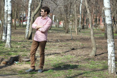 The guy in the park. Young boy walks in the early spring in a lush park royalty free stock photos