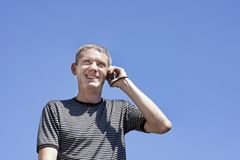 The guy with phone Royalty Free Stock Image