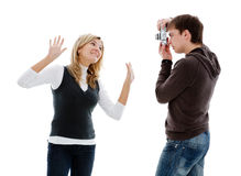 Guy photographed girl retro camera. Guy photographed girl retro camera, isolated on a white background Stock Photo