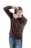 Guy photographed retro camera. Guy photographed retro camera, isolated on a white background Royalty Free Stock Images
