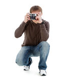 Guy photographed retro camera. Stock Photography