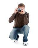 Guy photographed retro camera. Guy photographed retro camera, isolated on a white background Stock Photography