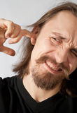 Guy picking his ear Royalty Free Stock Photography