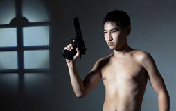 The guy with a pistol Stock Photography