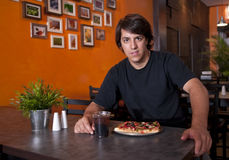 Guy in the pizza place Stock Photo