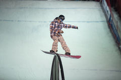 The guy in the plaid jacket snowboard slides Royalty Free Stock Photography