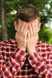 The guy covered his face with his hands, the man cries Royalty Free Stock Photos