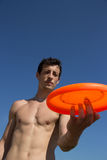 A guy play with frisbee. Frisbee freestyle in the summer time royalty free stock photos