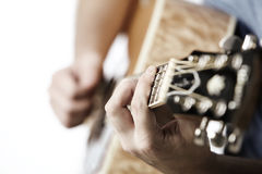 Guy playing an acoustic guitar Stock Image