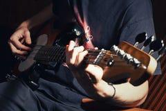 Guy playing bass. Guitar close royalty free stock photo