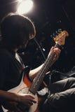 Guy playing bass guitar Stock Photo