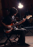 Guy playing bass guitar. Hairy guy playing bass guitar, rock star royalty free stock photography