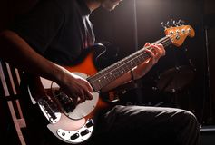 Guy playing bass. Guitar close-up. Rock music concepte royalty free stock photo