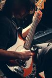 Guy playing bass. Guitar, guitar close-up. Rock music concepte royalty free stock images