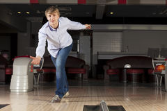 Guy playing bowling Stock Photography