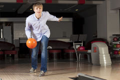 Guy playing bowling Royalty Free Stock Photo