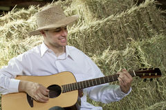 Guy Playing Country and Western Music on Guitar in Royalty Free Stock Photo