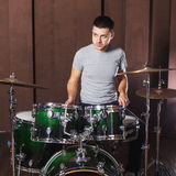 Guy playing the drums Stock Photography