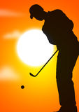 Guy playing golf. Young male playing golf in the evening Stock Photos