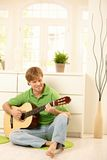 Guy playing guitar Royalty Free Stock Image
