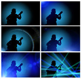 Guy playing the guitar - silhouette Royalty Free Stock Images