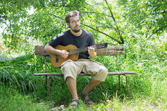 Guy playing guitar Stock Photos