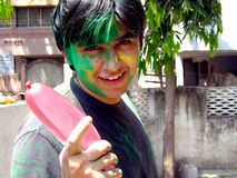 Guy playing Holi Stock Photography