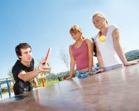 Guy playing ping pong Stock Photo