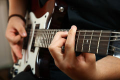 Guy plays the electric guitar. The guy plays the electric guitar on a black background stock photos