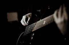 Guy plays guitar, black in white, soft focus, close up Royalty Free Stock Images