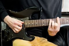 Guy plays guitar close up. Guy plays guitar close up stock images