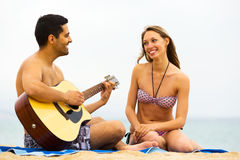Guy plays guitar for girlfriend Royalty Free Stock Photos