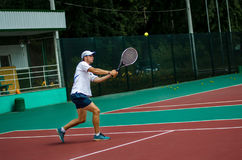 The guy plays tennis. On the cort royalty free stock image