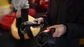 The guy play game in the VR headset virtual reality at a meeting events. The guy plays in the VR headset virtual reality at a meeting events of computer game stock video